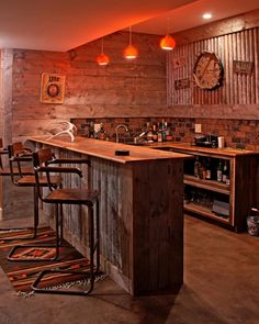 The wet bar in the family room was built by the owner with reclaimed wood and custom-finished corrugated steel.