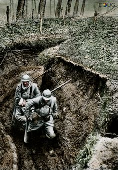 WW1 - French soldiers carrying a wounded soldier through the mud of the trenches.