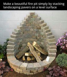 Teardrop shaped fire pit using landscape blocks. Very pretty