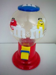 M&M Candy Dispenser. Everybody loves M&M candy and this is their favorite gumball dispenser where they store their precious treats. And when they are ready for one, they just press the lever and they fall right out. Yum.