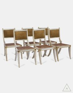 Set of six Regency style painted chairs with sabre legs and newly upholstered Andrew Martin tan suede back pad.  Explore interior design inspiration and shop vintage furniture, antique furniture, contemporary furniture and mid-century designs.