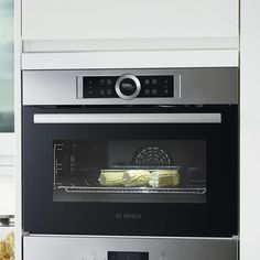 bosch serie 8 pyrolytic oven and microwave oven in brushed steel newrooms bosch. Black Bedroom Furniture Sets. Home Design Ideas