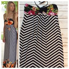 "Striped halter dress Such a beautiful dress!! Black and white striped maxi dress with red floral pattern on chest and hem. Halter has large beads and flattering gathers at bust. 5% spandex for easy movement, 47"" length from bust. By Saint tropez west. Dresses"