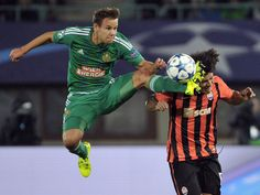 Vienna Rapid's Louis Schaub, left, and Shakhtar Donetsk's Marcio Azevedo challenge for the ball during a UEFA Champions League playoff, first leg soccer match in Vienna, Austria.  Hans Punz, AP