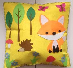 Fox and hedgehog felt cushion. Most decorations stuck on, tried to sew them on but the needle wouldn't go through the glue. Kit bought from B&M. 2015.