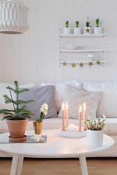 Scandinavian living room. I love the green plants whereas everything else is white or grey.