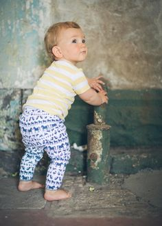 Baby Leo wearing Fable Baby organic cotton animal leggings in Navy & White (AUD$49) with Yellow Stripe Placket Tee (AUD$45)