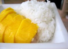 Coconut Sticky Rice with Mango...... I'm going to make this deliciousness with the Mangos from the tree outside my front door:)