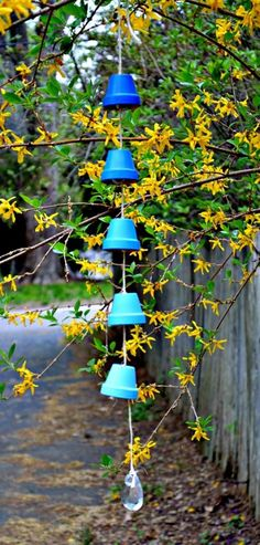 diy ombre wind chimes from clay pots 1 490x1024 13 Inspiring Projects That Use Mini Terracotta Pots