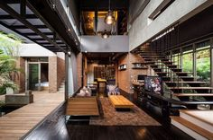 Central living area opens onto a courtyard and pool area in this home located in Bangkok, Thailand