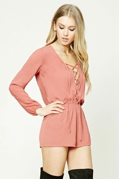Style Deals - A woven romper featuring a lace-up front, V-neckline, an elasticized waist, and long elasticized sleeves.