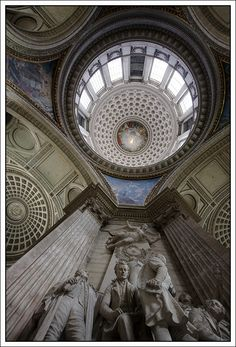 """The Panthéon (Latin Pantheon, from Greek Pantheon, meaning """"Temple of all the Gods"""") is a building in the Latin Quarter in Paris, France. It was originally built as a church dedicated to St. Genevieve, but after many changes now combines liturgical functions with its role as a famous burial place."""