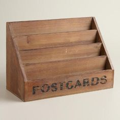 "Made of red-hued wood with a vintage feel, this appealing piece may be labeled ""postcards,"" but its four compartments - increasing in depth from front to back - are ideal for displaying anything from photos to greeting cards, or organizing papers and notes."