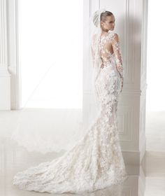 CAPRICORNIO, Wedding Dress 2015....according to The Knots gown price guide, Pronovias ranges from $1,500 to $3,000 which is my exact price range!