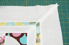 Mitered corners give a quilt a polished, classic look.     Adding sashing to the edge of your quilt top is also a quick way to make ...