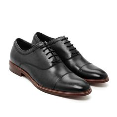 The bedrock of any great shoe collection, our Cap Toe Oxford is just the type of versatile shoe that no well-dressed man should be without. The foundation of any great shoe is exceptional leather and we selected our full-grain leather from one of the finest tanneries in Spain. Our shoes are hand-sewn and finished with a durable and comfortable rubber composite sole and a stacked heel that's going to stand up to countless days and nights of meetings, dinners, travel, and more. The best thing…