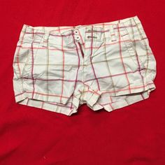 Plaid shorts Orange, dark pink, white, and tan plaid aero shorts. Back pockets button open and close. Really soft and comfy. Clean and has no holes or rips. From a smoke/pet free home. Aeropostale Shorts
