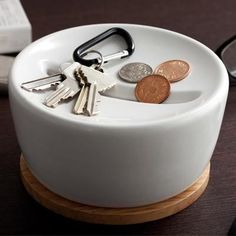 Tray for keys and wallet, with integrated coin storage.
