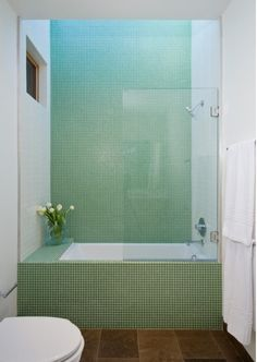 Green tile is trending in interior design. Here are 35 reasons why we can't get enough green tile. For more interior design trends and inspiration, visit domino. Bathroom Design Inspiration, Bad Inspiration, Design Ideas, Tub Shower Combo, Shower Tub, Glass Shower, Shower Faucet, Bad Set, Bathroom Sets