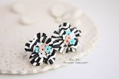 Polymer clay earrings white black streaks and a color explosion