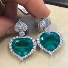 Hearts shape diamonds and emeralds earrings