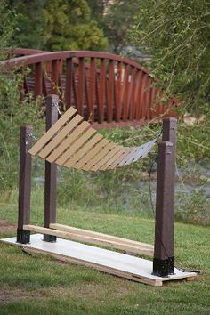 Musical bars of coated fiberglass hang between a sturdy frame made of recycled plastic posts. The Amadinda is an ancient xylophone from Uganda.