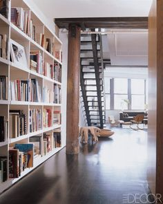Julianne Moore and Bart Freundlich West Village loft. The bookshelves were custom made by craftsman Joe Terzano. Julianne Moore, West Village, Elle Decor, Custom Bookshelves, Bookcases, Bookcase Wall, Inspiration Design, Home Libraries, Cozy Living Rooms