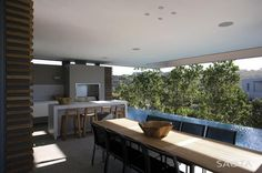 Home Embraces Indoor-Outdoor Lifestyle as it Steps Down Slope