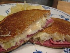GRILLED REUBEN}  RYE BREAD, SWISS CHEESE, SAUERKRAUT, PASTRAMI OR CORNED BEEF, BUTTER and 1000 ISLAND DRESSING . . . . . EASY TO MAKE!