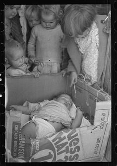 While the mothers are working in the fields, the preschool children of migrant families are cared for in the nursery school under trained teachers, Kern migrant camp, California, 1936 - Dorothea Lange.and i love the history Vintage Pictures, Old Pictures, Old Photos, Antique Photos, Dorothea Lange Photography, Dust Bowl, Great Depression, Documentary Photographers, Jolie Photo