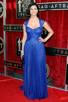 Morena Baccarin - a slightly-sheer, blue, draped tulle, cap-sleeved Monique Lhuillier gown.