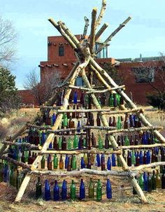 A native american bottle tree/ Tee Pee??? http://media-cache2.pinterest.com/upload/252764597805693499_vk8Zec6f_f.jpg treswages jars and light bulbs and bottles