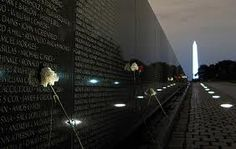 Washington DC | Vietnam Wall Memorial with the Washington Monument in background.