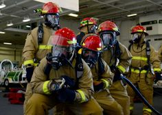 SAN DIEGO (Jan. 16, 2014) Sailors practice firefighting techniques during a fire drill aboard the aircraft carrier USS Ronald Reagan (CVN 76). Ronald Reagan is moored and homeported at Naval Base Coronado. (U.S. Navy photo by Mass Communication Specialist Seaman Jonathan A. Nelson/Released)