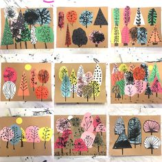 Create a forest with colored paper and black paint