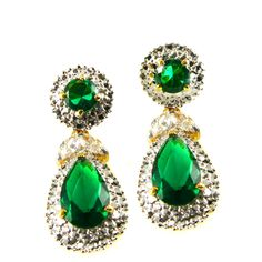 Jacqueline Kennedy's Emerald Drop Earrings - Newly elected President John F. Kennedy presented Jackie w/ a gorgeous suite of emerald jewelry ( necklace, bracelet, and matching earrings w/ removable drops) to express his gratitude for her work during his presidential campaign. Mrs. Kennedy wore the necklace & earrings to the Inaugural Ball, continued to wear the pieces together & separately on many other occasions - repro from John F. Kennedy Presidential Library & Museum's Online Store