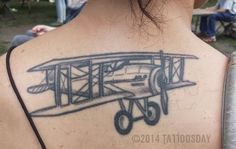 Tattoosday (A Tattoo Blog): Nicole's Airplane Soars Across Her Back  Spotted at The New York City Poetry Festival last month: http://tattoosday.blogspot.com/2014/08/nicoles-airplane-soars-across-her-back.html