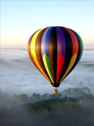 This would be incredible! Thinking of a hot air balloon tattoo in black white, with a dark figure reaching for the stars. Maybe with the balloon in color.