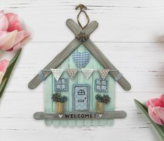 Lollystick House, welcome wall hanging Popsicle Stick Houses, Popsicle Stick Crafts, Craft Stick Crafts, Paper Crafts, Lolly Stick Craft, Ice Cream Stick Craft, Fun Crafts For Kids, Diy Home Crafts, Diy Arts And Crafts