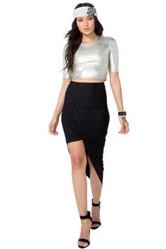 A trendy wrap-style skirt, featuring a draped silhouette and an elasticized waist. Finished asymmetric hem. Looks amazing with a fitted top and strappy heels. $21.50