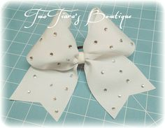 White Cheer bow with all over diamonds by Two Tiara's Bowtique on Etsy or Facebook as TwoTiaras Bowtique!  Teams, squads, state, competition, softball, pro shops!  Check out this item in my Etsy shop https://www.etsy.com/listing/216864144/white-diamond-cheer-bow-team-discounts