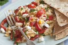 scrambled eggs with feta, tomatoes and dill