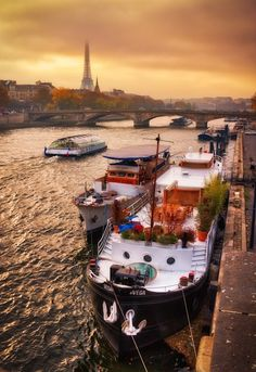 House Boats on the Seine - Paris. How cool would it be to have one of these?