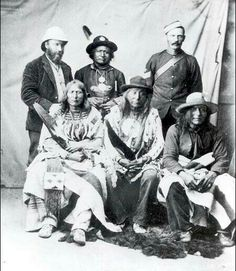 L-R seated: Crowfoot ,Blackfoot, Sitting on an Eagle ,Tail Peigan and Three Bulls ,Blackfoot.Standing middle:Red Crow ,Blood. standing, Jean L'Heureux interpreter at Treaty No. 7 and Sgt. W. Piercy ,NWMP, Regina.