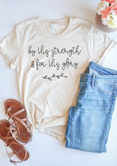 Everything we do in this life is for His glory and no matter what He's called us to do, we can do it by His strength. Grab this adorable tee to remind your heart of this truth. And, it looks so cute paired with jeans and sandals ; Christian Clothing, Christian Shirts, Christian Women, Cute Shirt Designs, Jesus Shirts, Vinyl Shirts, Shops, Cricut Creations, Diy Shirt