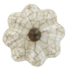 These knobs may look even better.  Medium Tan & White Crackle Ceramic Scallop Knob