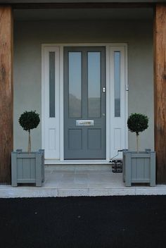 Garden Planter, Sarratt Range Adoored have one quite similar to this - We know it as a Victorian Ascot Classic Composite door. Shown in Grey.Adoored have one quite similar to this - We know it as a Victorian Ascot Classic Composite door. Shown in Grey. Grey Composite Front Door, Grey Front Doors, Front Door Porch, Beautiful Front Doors, House Front Door, Front Door Colors, Front Entry, Solid Wood Front Doors, Front Door Planters