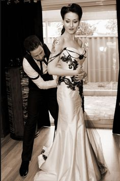 Beautiful victorian gothic wedding dress.  http://m.flickr.com/lightbox.gne?id=6289098862