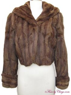 "SOLD! Vintage Brown Squirrel Fur Jacket #S721; Very Good Condition; 2 - 6. This is a beautiful genuine brown squirrel fur jacket in a short, waist length that has all the charm of the days of old. It has a ""Styled by Steve Stevens"" label and features a large shawl collar, with fur on the underside as well, and non-adjustable turn-back cuffs. This is a very versatile fur jacket that could dress up your holiday outfit or even be thrown over a pair of jeans and a t-shirt and look fabulous!"