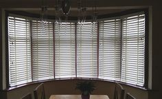 Wood venetians are perfect for this 6 section bay window in Knightsbridge. We fitted chalk wood venetians with matching tapes. http://www.theblindshop.com